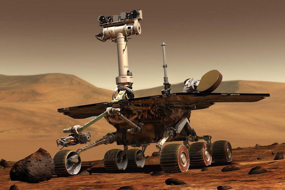 <strong>Савршенија сонда <em>Opportunity</em> са роботским рукама, 2004.</strong> (Откривена куглица хематита као доказ да је на Марсу било воде)